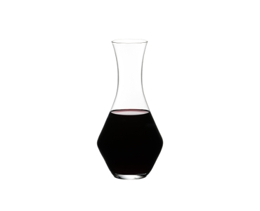 RIEDEL Decanter Merlot filled with a drink on a white background
