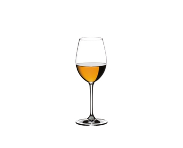 RIEDEL Vinum Sauvignon Blanc/Dessertwine glass filled with dessert wine on a table next to a plate with a chocolate muffin