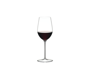 A RIEDEL Sommeliers Zinfandel/Riesling Grand Cru glass filled with white wine on white background. The Sommeliers logo below the glass.