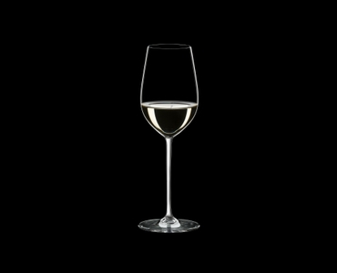 RIEDEL Fatto A Mano Riesling/Zinfandel White R.Q. filled with a drink on a black background