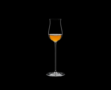 RIEDEL Veritas Spirits filled with a drink on a black background