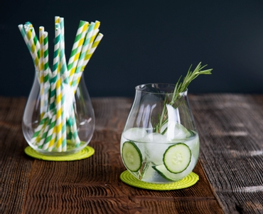 4 decorated gin cocktails served in RIEDEL Gin glasses stand slightly offset side by side on a white background