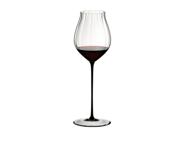 RIEDEL High Performance Pinot Noir Black filled with a drink on a white background