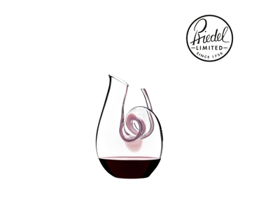 RIEDEL Decanter Curly Mini filled with a drink on a white background