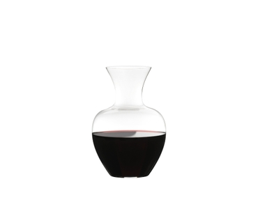 RIEDEL Decanter Apple NY filled with a drink on a white background