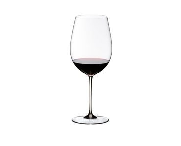 A red wine filled RIEDEL Sommeliers Bordeaux Grand Cru glass on white background