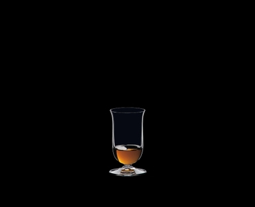 RIEDEL Bar Single Malt Whisky filled with a drink on a black background