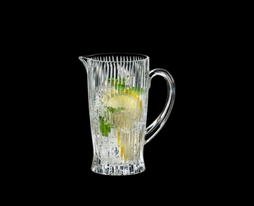 RIEDEL Tumbler Collection Fire Pitcher filled with a drink on a black background