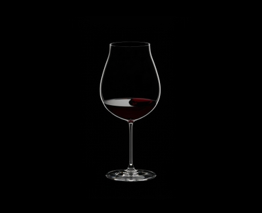 RIEDEL Veritas New World Pinot Noir/Nebbiolo/Rosé Champagne Glass filled with a drink on a black background