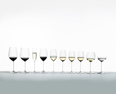 Ten different, with red wine, white wine and sparkling wine filled RIEDEL Superleggero glasses on a light grey ground