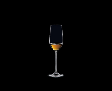 RIEDEL Ouverture Tequila filled with a drink on a black background
