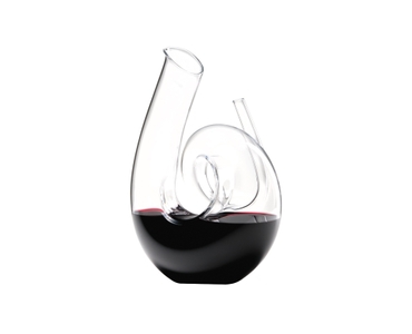 RIEDEL Decanter Curly R.Q. filled with a drink on a white background