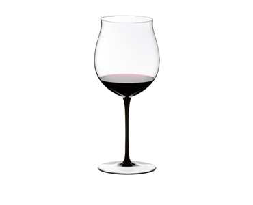 RIEDEL Sommeliers Black Tie Burgundy Grand Cru filled with a drink on a white background
