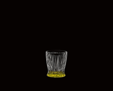 RIEDEL Tumbler Collection Fire Whisky Easter Yellow on a black background