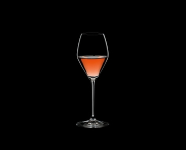 RIEDEL Extreme Restaurant Rosé/Champagne filled with a drink on a black background