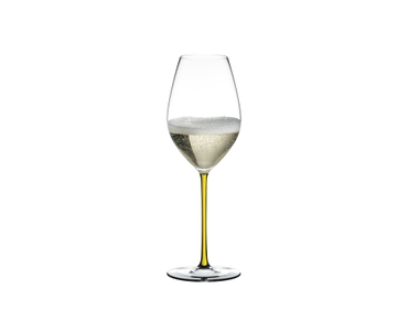 RIEDEL Fatto A Mano Champagne Wine Glass Yellow filled with a drink on a white background
