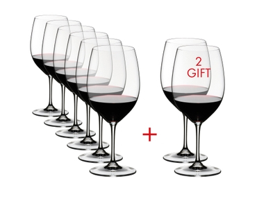 6 RIEDEL Vinum Cabernet Sauvignon/Merlot (Bordeaux) glasses are slightly offset one behind the other on the right and two glasses on the left. A red plus sign is placed between the glasses. All 8 wine glasses are filled with red wine.