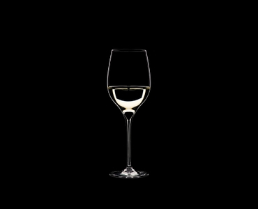 RIEDEL Grape@RIEDEL Viognier/Chardonnay filled with a drink on a black background