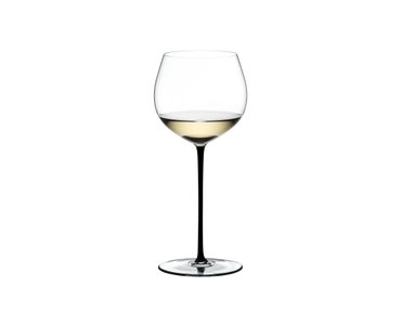 RIEDEL Fatto A Mano Oaked Chardonnay Black filled with a drink on a white background