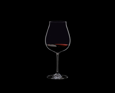 RIEDEL Restaurant New World Pinot Noir filled with a drink on a black background