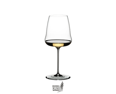 A RIEDEL Winewings Chardonnay glass filled with white wine
