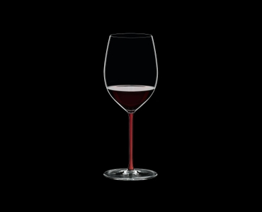 RIEDEL Fatto A Mano R.Q. Cabernet/Merlot Red filled with a drink on a black background