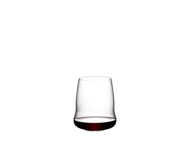 A SL RIEDEL Stemless Wings Cabernet Sauvignon tumbler filled with red wine is held by a brunette lady.