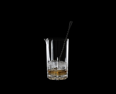 SPIEGELAU Perfect Serve Mixing Glass filled with a drink on a black background