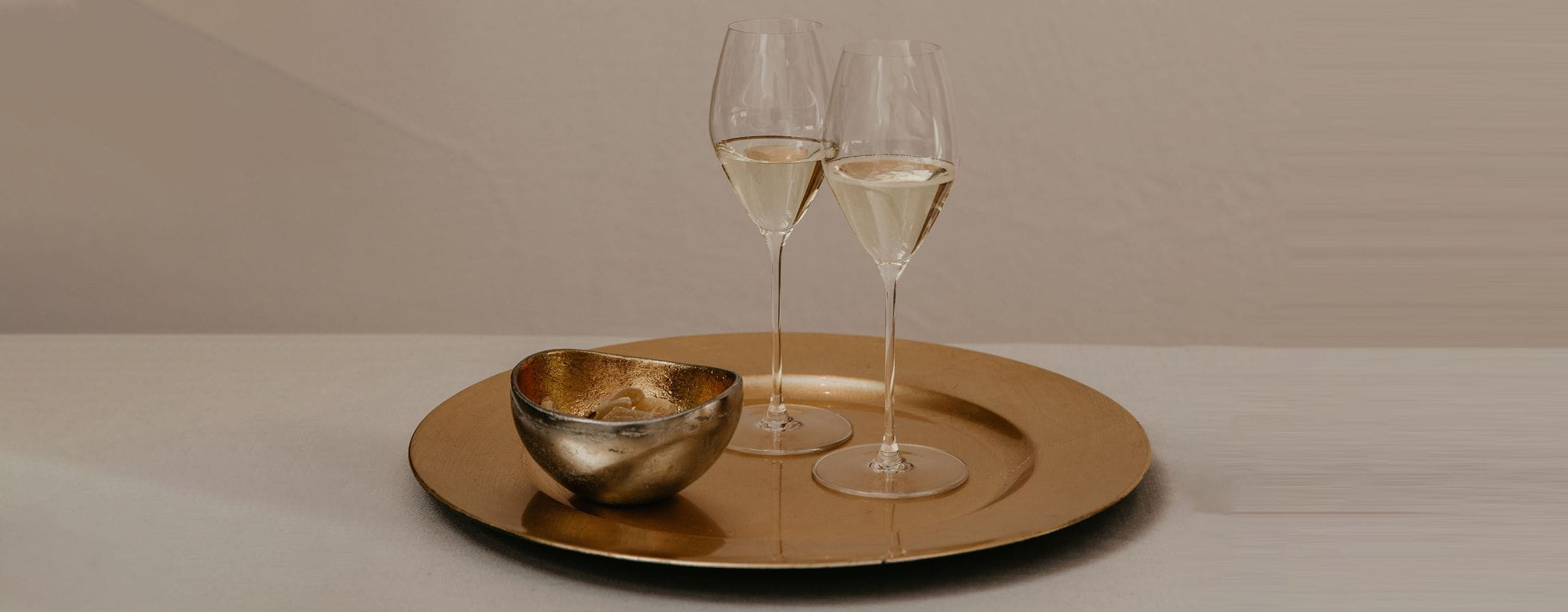 RIEDEL Performance Champagne glasses on a gold tray