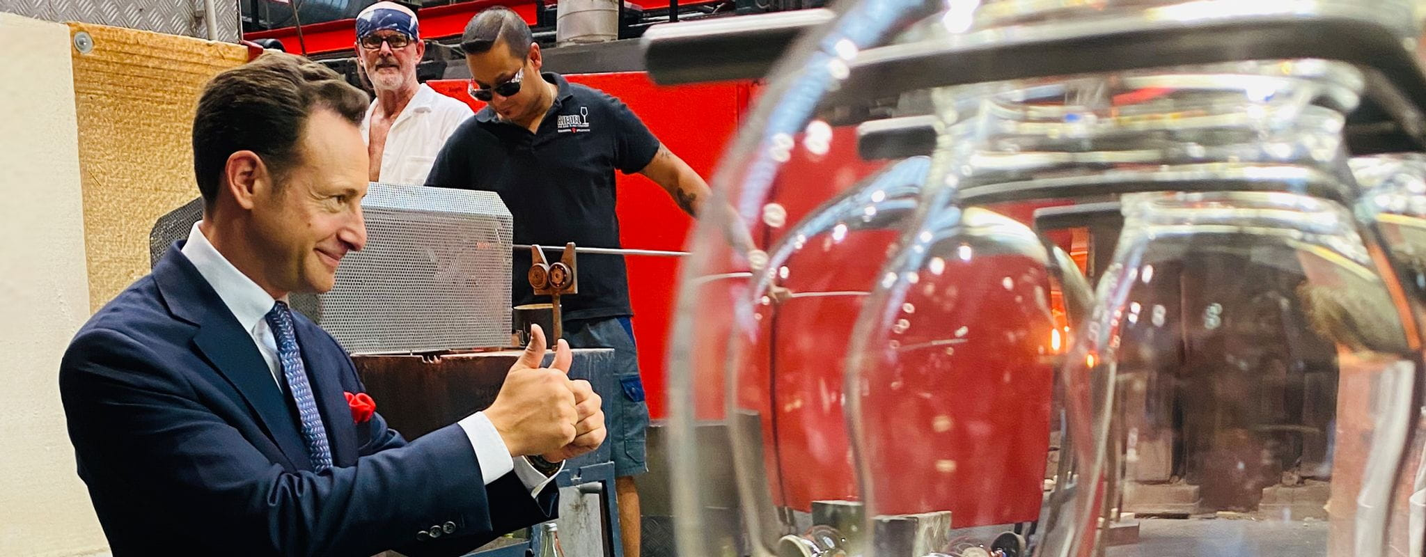 Maximilian Riedel gives thumbs up to the glass blowers