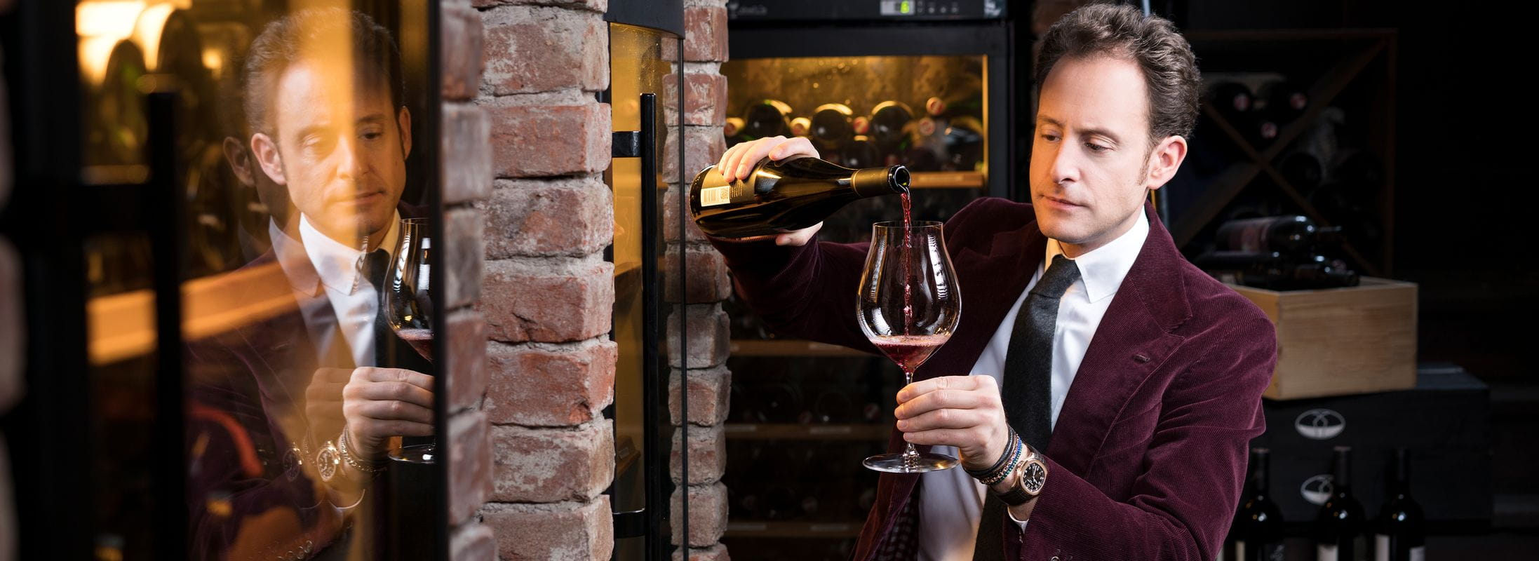 Maximilian Riedel enjoys wine from a RIEDEL Performance Pinot Noir glass
