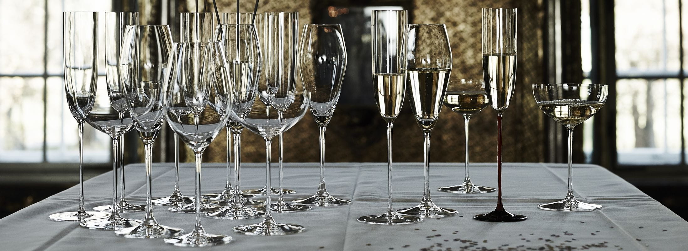 Several Champagne and sparkling wine glasses at a glance