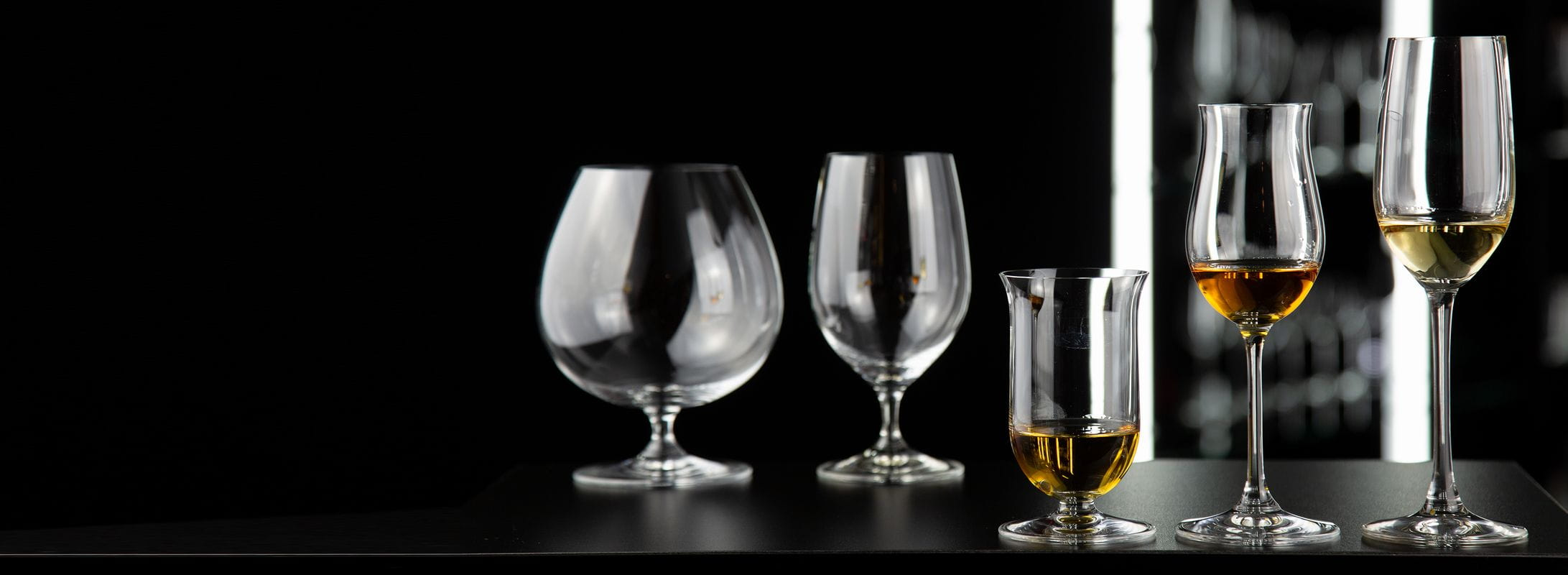 The RIEDEL Bar collections on a black table.