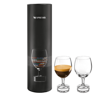 2 NESPRESSO Reveal Mild glasses next to the corresponding sales packaging