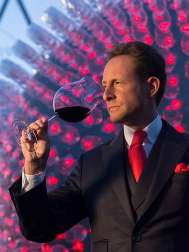 Maximilian Riedel smells the wine in a RIEDEL Superleggero Burgundy Grand Cru glass