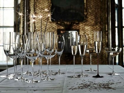 A collection of champagne flutes and glasses