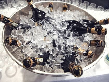Champagne bottles in an ice bucket