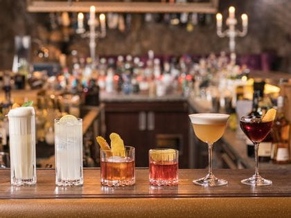 RIEDEL Drink Specific Glassware on a bar counter