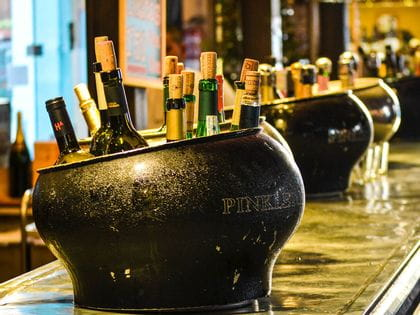 Full ice buckets lined up on bar
