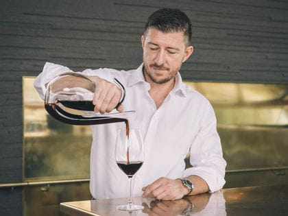Mark Baulderstone pouring red wine with Ayam Decanter