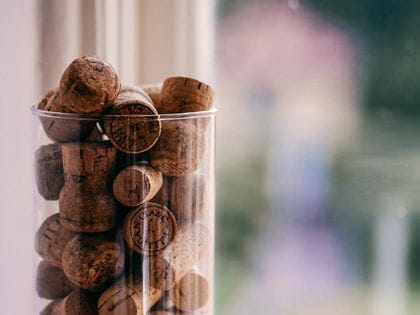 Champagne corks in glass jar