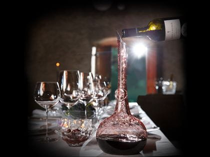 A festively laid table with RIEDEL Superleggero glasses and a RIEDEL Decanter Superleggero