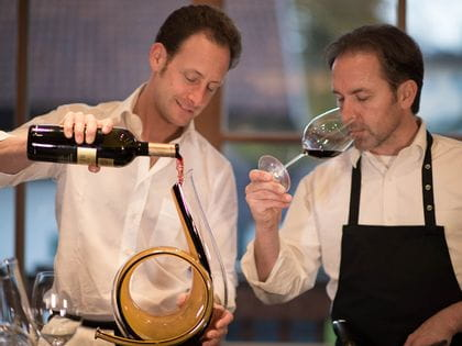 Two men decanting and enjoying red wine in RIEDEL