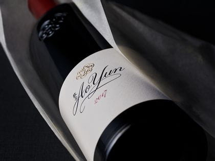 Bottle of Ao Yun red wine vintage 2017 wrapped in silk paper
