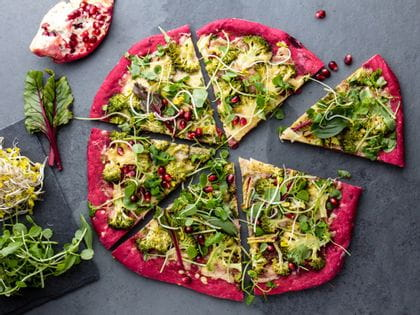 Vegetarian pizza with beetroot dough and a glass of fruity-spicy Chianti Classico