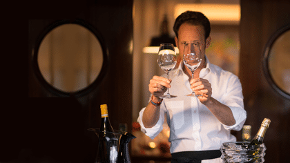Maximilian J. Riedel is checking two RIEDEL Veritas Champagne Wine Glasses before presenting to his guests.