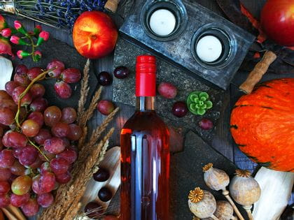 Bottle of wine surrounded by fruit