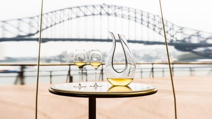 A filled decanter Amadeo Black Tie and two RIEDEL Veritas Champagne wine glasses