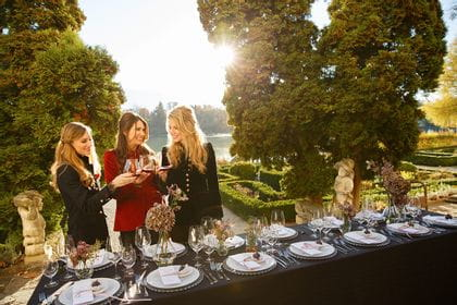 A group of friends is raising the glass on an autumn garden party