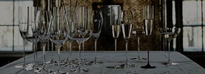 Several champagne glasses on a table 40% darker opacity